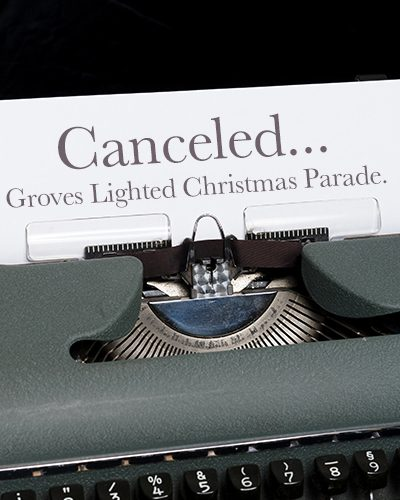 Typewriter with paper stating Canceled... Groves Lighted Christmas Parade